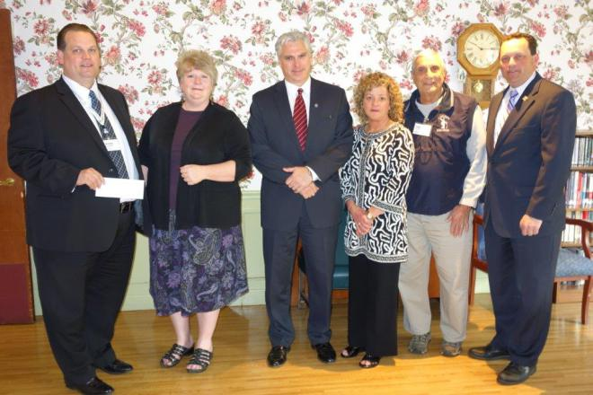 Rotary presents check to Seacoast for patient area upgrade