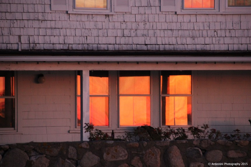 november 21, 2015 sun reflecting on windows of the house on the water