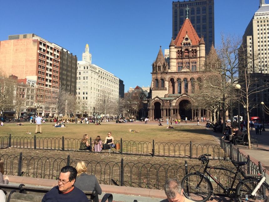 The first halter top in Copley Square. Sure sign of spring. Notice bike with fishing pole holder. Soon.