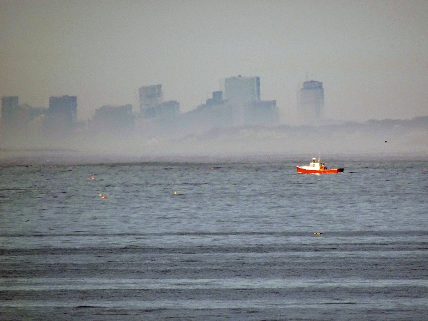 red boat and boston skyline