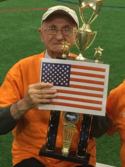 albanian-with-trophy-and-american-flag
