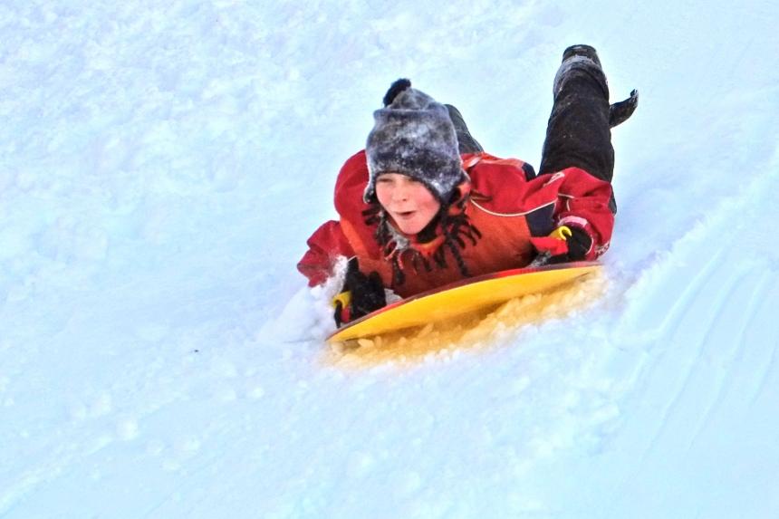 sledding-east-gloucester-kids-bass-rocks-atticus-copyright-kim-smith