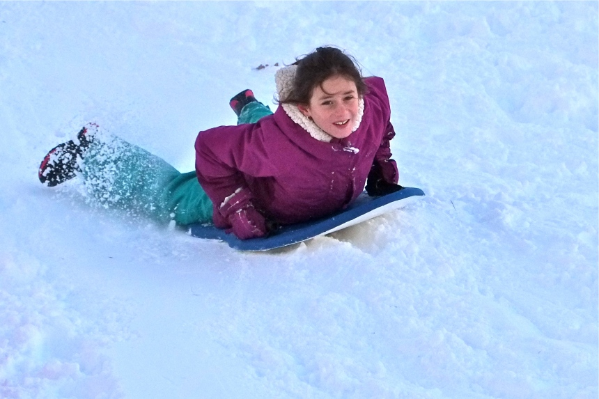 sledding-east-gloucester-kids-bass-rocks-esme-1-copyright-kim-smith
