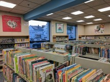 New temporary shelving in children's