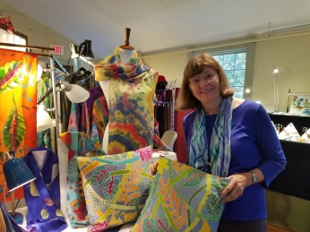 Candace Wheeler - artist at Ten Pound Studio showing pillows this year; Leslie Pearlman scarf on form behind