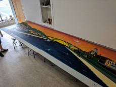 In process- Jason Burroughs taking care of faded mural; worked on it at HIVE location, Cape Ann Art Haven