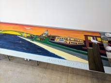 In process - Jason Burroughs working on mural