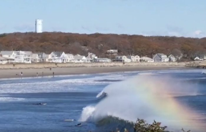 surfing through rainbows wave spray