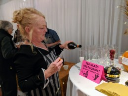 Taste of Cape Ann YMCA Sea Glass Restaurant Castle Manor Inn Laura Dow pouring champagne and chambord 20171109_180848