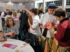 Taste of Cape Ann YMCA teens help host the event helping sell raffle tickets 20171109_182700