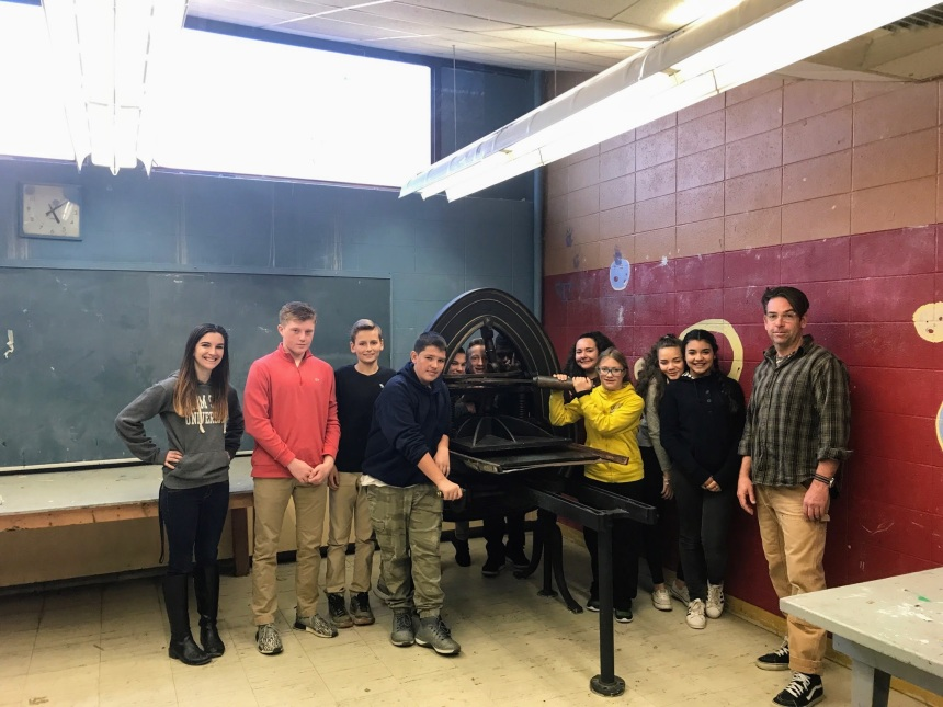 teachers Brett Dunton and Ashley Doke with 8th grade students admiring the newly installed famous Acorn press O'Maley Innovation Middle School, Gloucester MA
