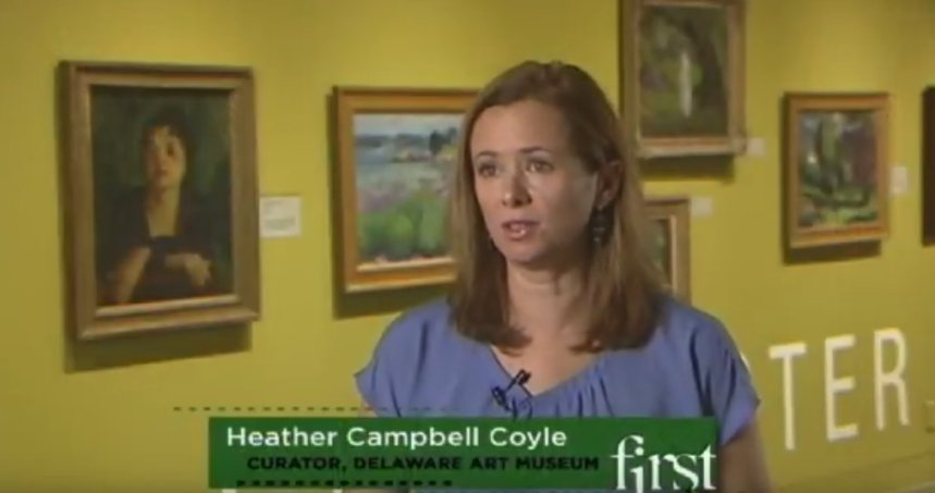 Curator Coyle interviewed Delaware Art Museum in front of Gloucester wall of John Sloan retrospective