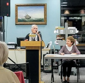 Installation view FITZ HENRY LANE PAINTING Coasting Schooner off Boon Island Maine_Mary Weissblum Smith speaking at Sawyer Free library Oct 2016 190244 ©C Ryan