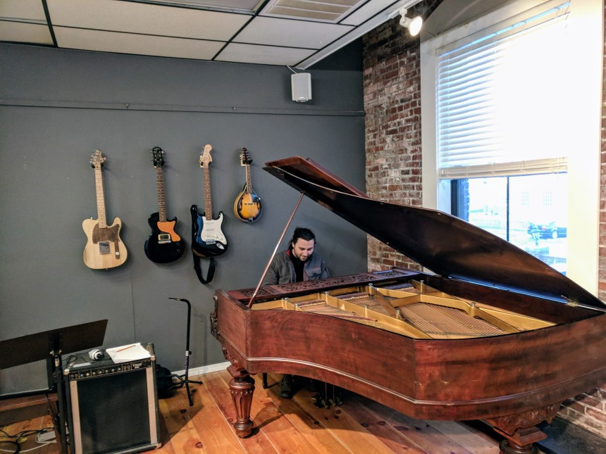 Zach Gorrell at Sound Harbor demonstrating new baby grand donated by Mac Bell ©c ryan Jan 2018_161254.jpg