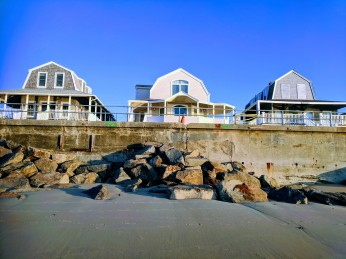 Rockport DPW stacking boulders along rip rap like pyres bulwark against seawall collapse May 2 2018 ©c ryan
