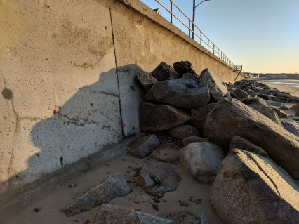 Rockport DPW stacking boulders along rip rap like pyres bulwark against seawall collapse May 2 2018 ©c ryan_061031