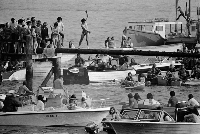 4th of july greased pole walk over water glouceter ma by 1973 by Spencer Grant