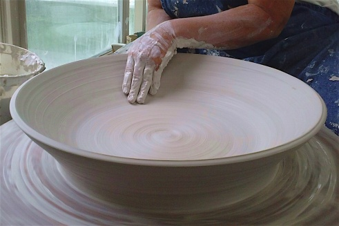 Curtis - Wheel throwing large platter.jpg