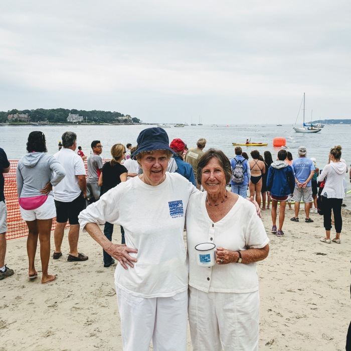 Sarah Robbins Evans on the right with Barbara Blais watching 40th Anniversary Celebrate Clean Harbor Swim_Evans co founder both swam it many years _20180811_©c ryan Gloucester Mass