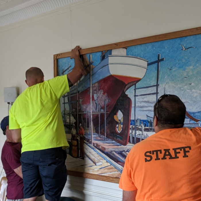 Gloucester Ma Public Works_reinstalling  restored KEN GORE painting to City Hall_Gloucester Mass_20180907_©c ryan.jpg