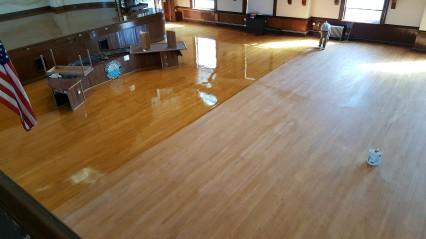 DURING Gloucester City Hall Kyrouz Auditorim DPW working on floors©Bobby