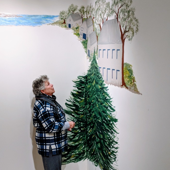 portrait of Bonnie L Sylvester_ inspecting her public mural in process_Cape Ann Museum_ _20181214_© catherine ryan.jpg
