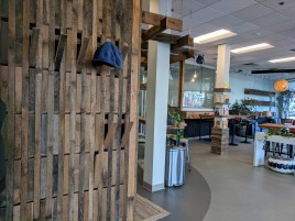 wood slat wall coat rack_GATHR work_ inviting modern warm design for new coworking office space Ipswich Mass_ winter 2019_© catherine ryan (1)