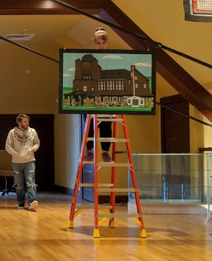 artist Alexia Paker on ladder_installating her series Hometown for TOHP Essex Town Hall_20190427_Once Upon a Contest © c ryan