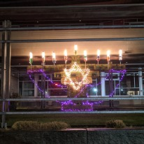 last candle lit_Lobster Trap Menorah_Temple Ahavat Achim_Gloucester Mass._photograph copyright ©c ryan
