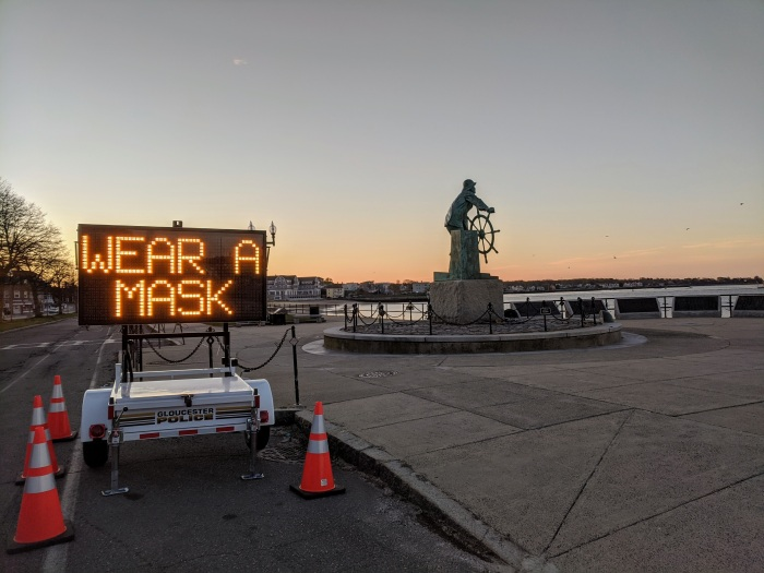 WEAR A MASK_Man at Wheel memorial_Signs of the times_Gloucester Mass., 6 May 2020, covid-19 © c ryan