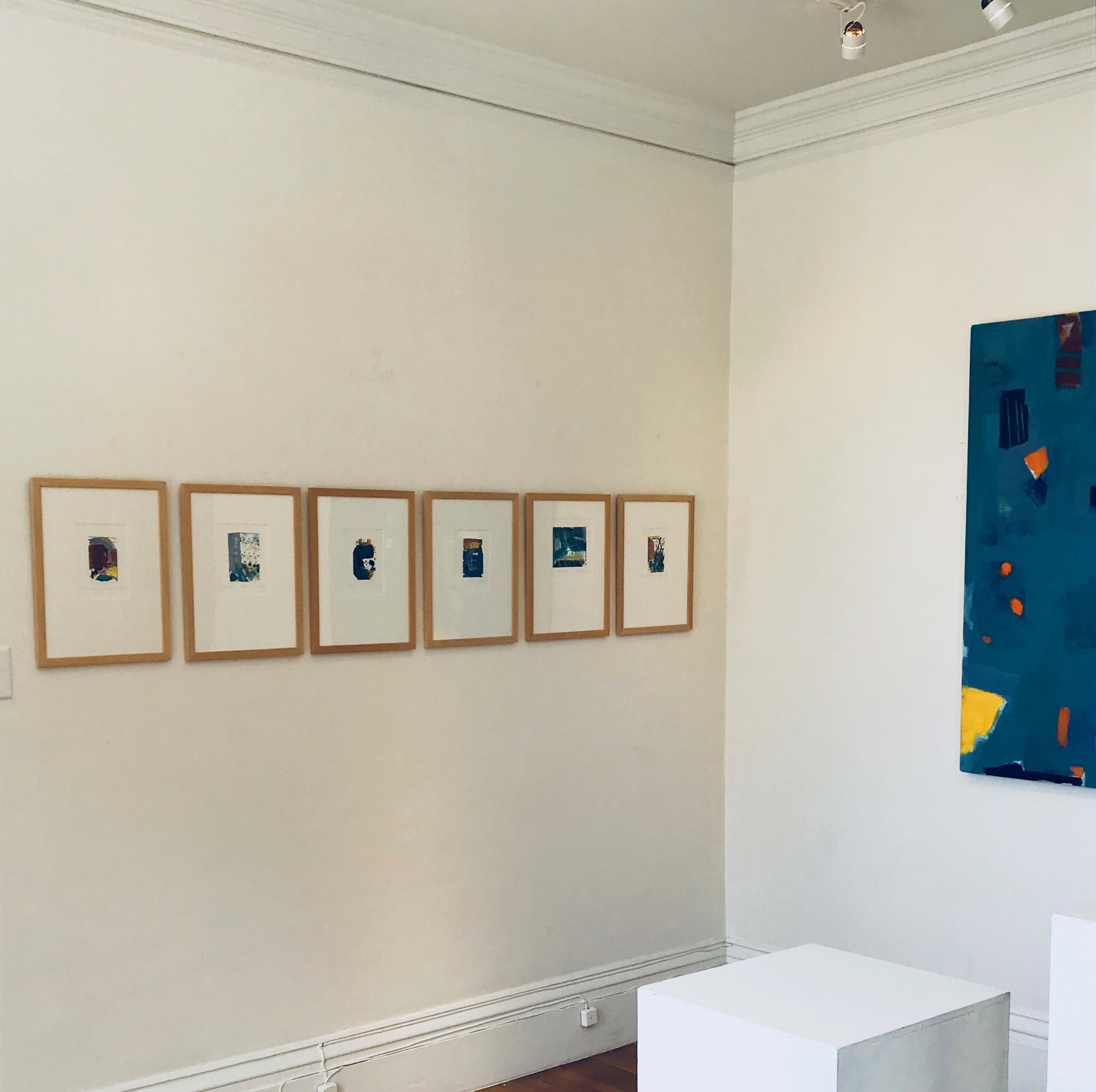Six framed works . Untitled (Blue) on adjacent wall